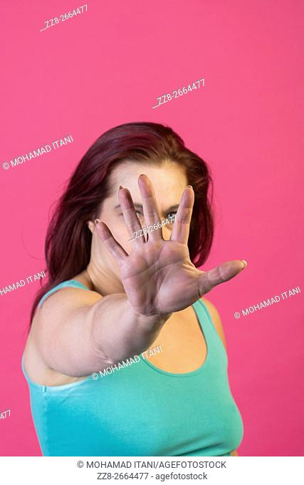 Woman showing a talk to the hand gesture