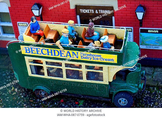 Village bus drives through Bekonscot in Beaconsfield, Buckinghamshire, England, is the oldest original model village in the world