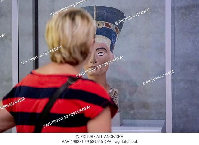 """31 August 2019, Berlin: At the Long Night of the Museums in the James Simon Gallery, a visitor looks at the work """"""""Nefertiti"""