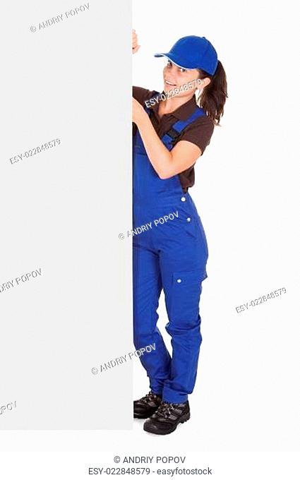 Female plumber holding blank placard