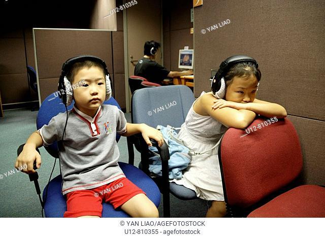 In library children watching movie