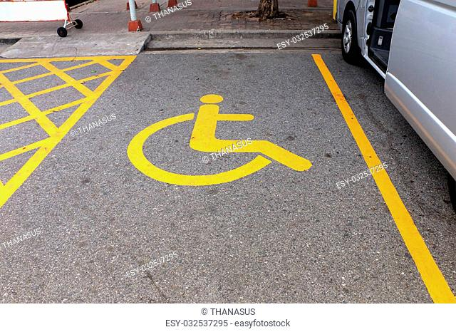 Disabled parking sign. Parking for disabled, handicapped citizens. Empty parking lot