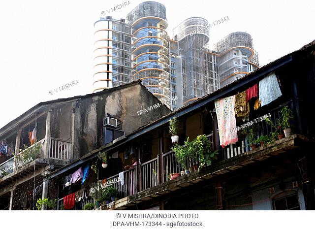 Old daruwala chawl and skyscraper ; Ganpatrao kadam marg ; Lower Parel ; Bombay Mumbai ; Maharashtra ; India 26-August-2009