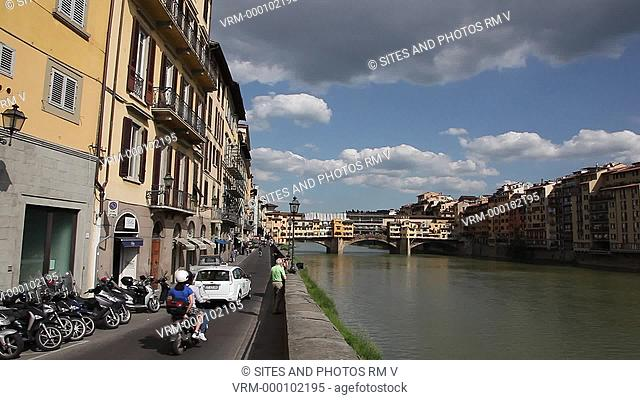 Exterior, LS, PAN, daylight, view of the Arno River downstream. Seen is the Ponte Vecchio, the oldest bridge of Florence, built in 1345 by Neri di Fioravante