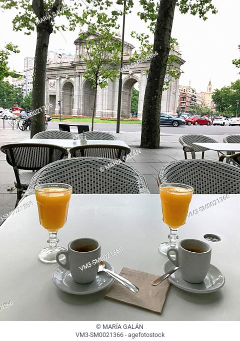 Two cups of coffee and two glasses of orange juice in a terrace. Independencia Square, Madrid, Spain