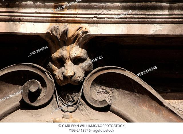 Lion head sculpture on building in street road in rome italy