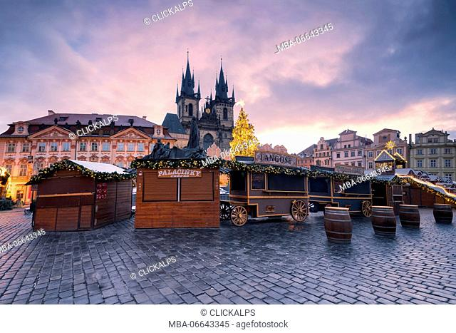 Prague, Czech Republic The Church of Saint Mary of Tyn photographed at dawn, in the foreground Christmas stalls
