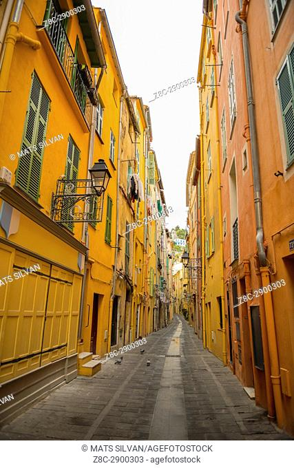 Narrow Street with Old Buildings in Old Town in Menton, Provence-Alpes-Côte d'Azur, France