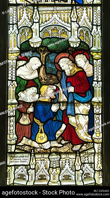 Stained glass depicting St Paul healing the sick, St Mary's Priory Church, Abergavenny Wales UK. May 2019