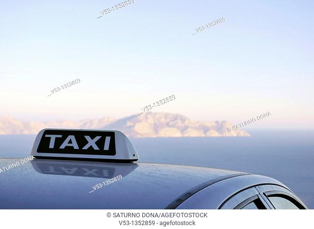 taxi in front of the sea