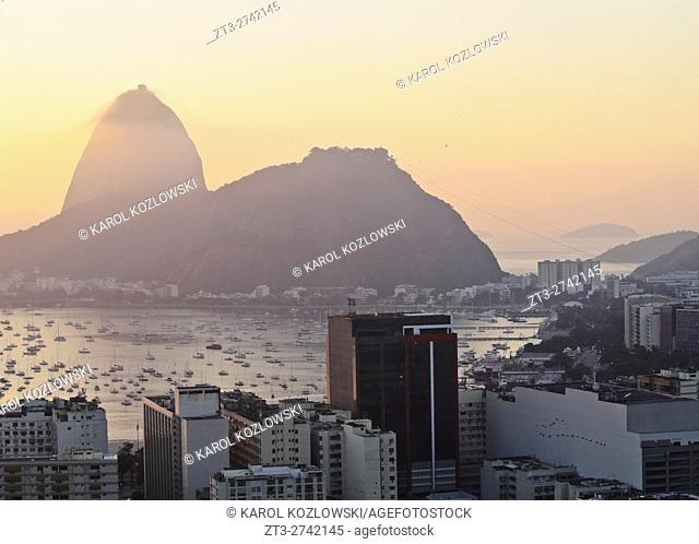 Brazil, City of Rio de Janeiro, View over Botafogo Neighbourhood towards the Sugarloaf Mountain at sunrise