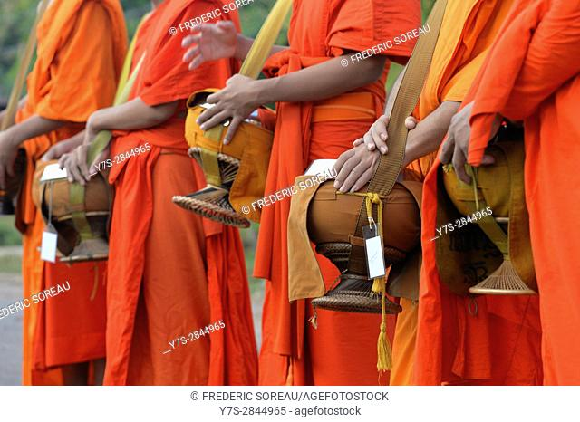 Buddhist monks walking along road to collect alms, Four Thousand island,South Laos,Southeast Asia