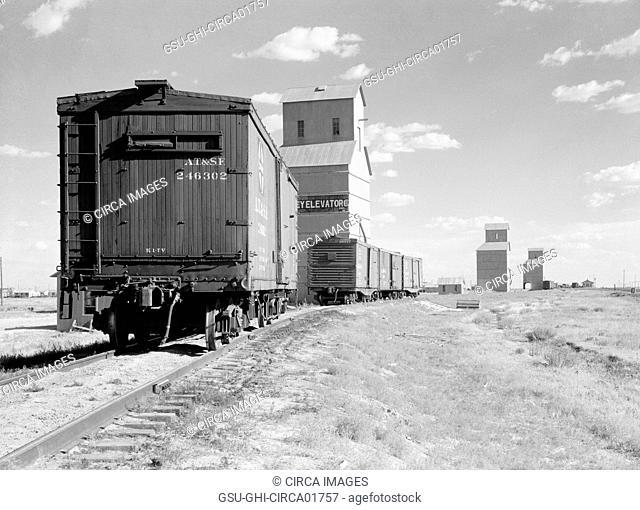 Freight Trains and Grain Elevators, Dumas, Texas, USA, Arthur Rothstein for Farm Security Administration (FSA), July 1936