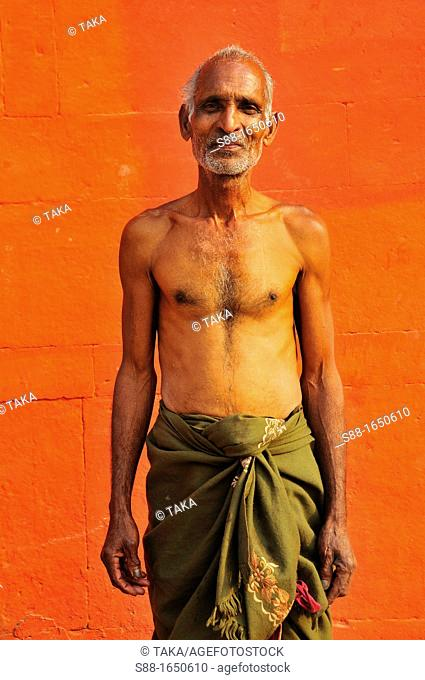 The man by the ghat after bathing in the Ganges river