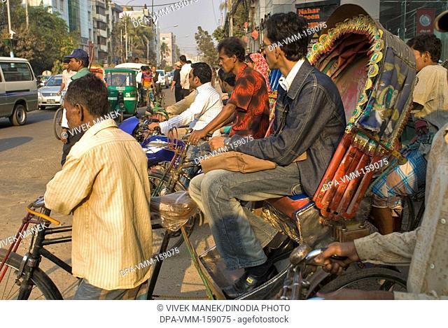 Cycle rickshaws on road ; Dhaka ; Bangladesh