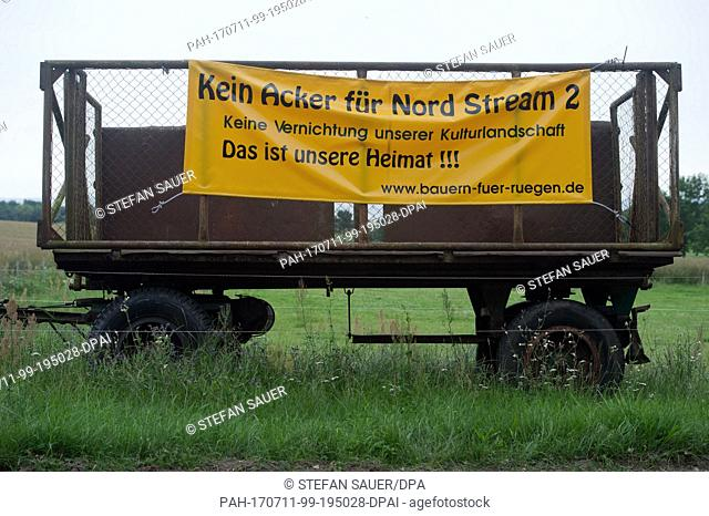 A banner with the slogan 'Not an acre for Nord Stream 2' (German: 'Kein Acker fuer Nord Stream 2') hangs from an agricultural trailer in Putbus on the Baltic...