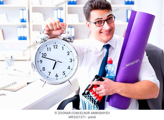 Businessman rushing to sports with clock