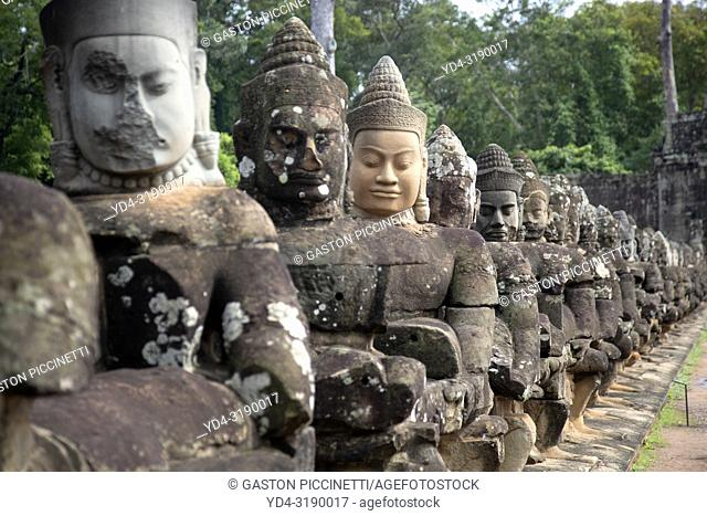Detail of the stone faces on the bridge at the south gate of Angkor Thom, Angkor Temples complex, Siem Reap Province, Cambodia, Asia.