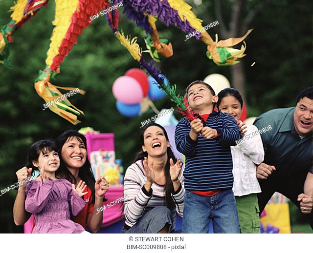 Young boy swinging at a pinata