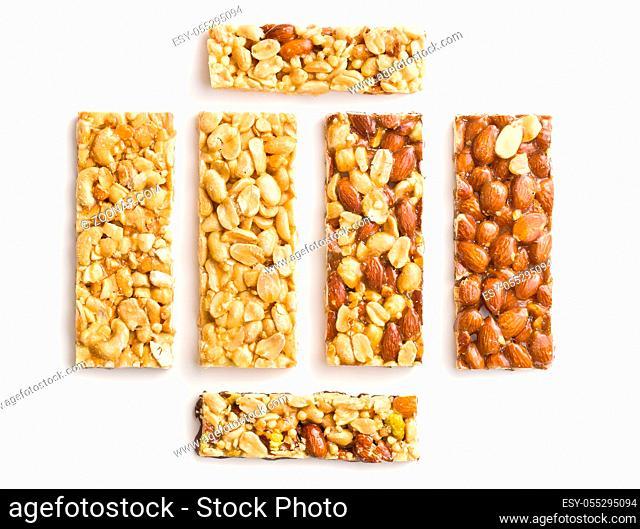 Sweet nut bars with honey isolated on white background