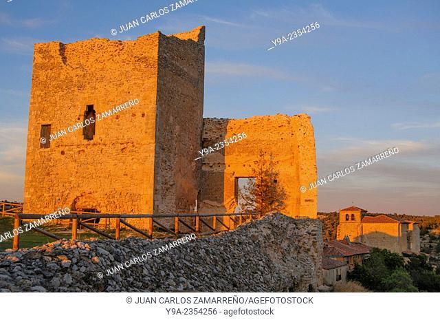Calatanazor castle detail and church at dusk, Calatanazor, Soria, Castilla y Leon, Spain