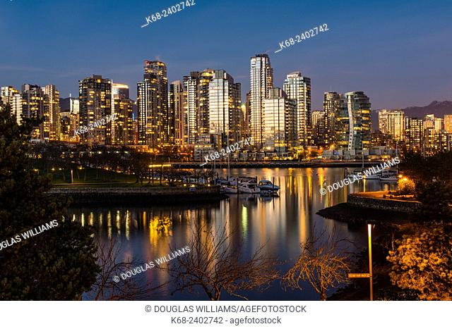 Alder Bay at sunset, with reflections of downtown buildings, Vancouver, BC, Canada