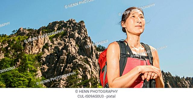 Female hiker looking out to view on way to Daecheongbong peak, Seoraksan National Park in South Korea