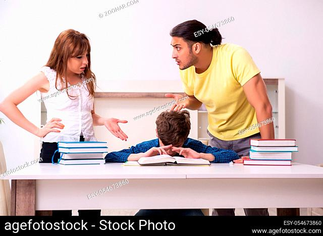 The parents helping their son to prepare for school