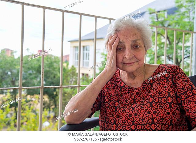 Portrait of elderly woman in a nursing home, smiling and looking at the camera
