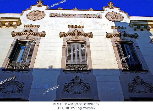 windows of the modernist facade of the spa Prats, Caldes de Malavella, Catalonia, Spain
