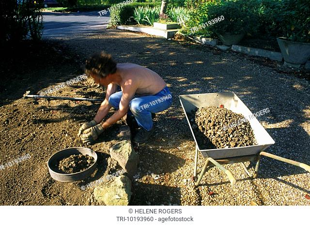 Sifting Soil To Make A New Lawn