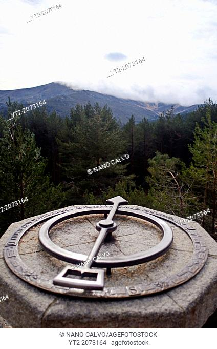 Metal compass on rock at Peñalara, highest mountain peak in the mountain range of Guadarrama, Spain