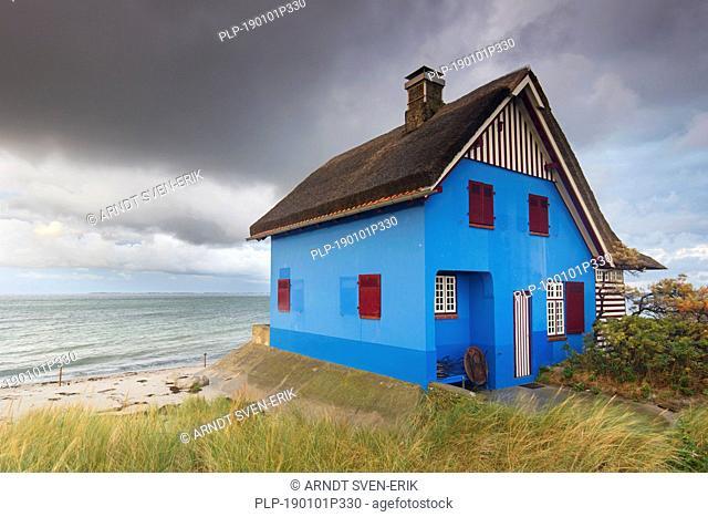 Blue beach house on the peninsula Graswarder, Heiligenhafen, Schleswig-Holstein, Germany