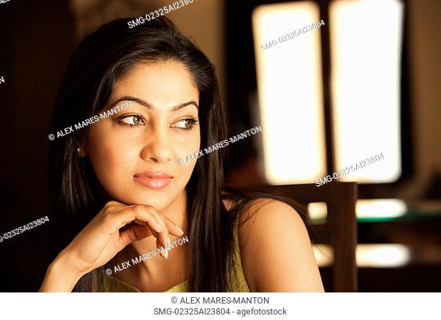 woman resting chin on hand horizontal