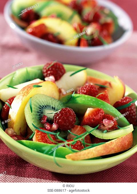 mixed fresh fruit with pomegranate