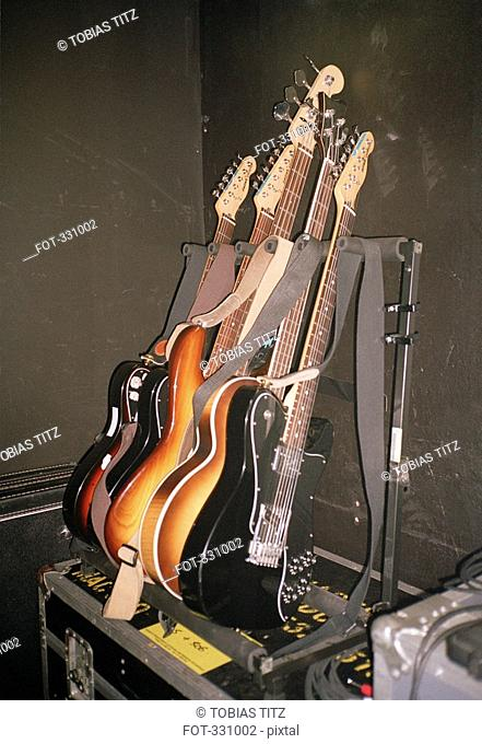Electric guitars arranged on rack