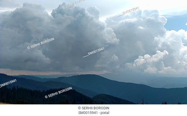 Mountains and clouds in dark summer day Storm sky in Ukraine Karpathians nature