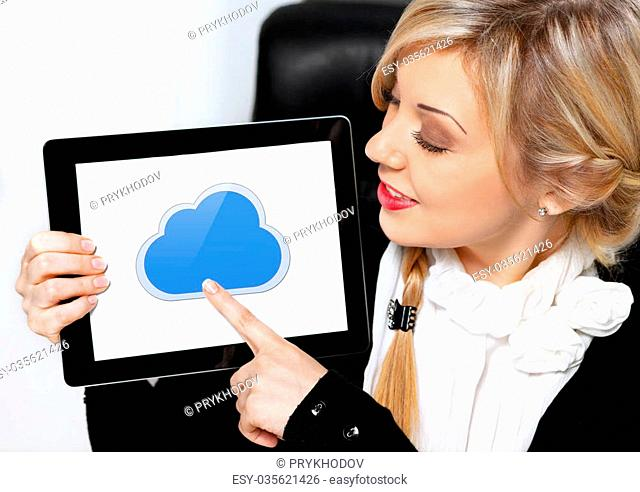 businesswoman holding a tablet pad with cloud on a screen