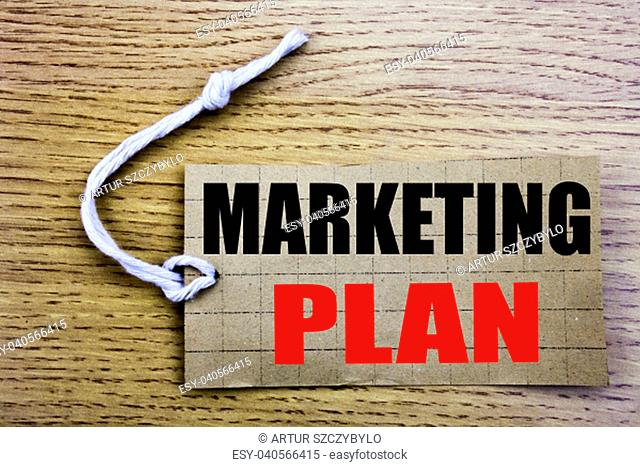 Marketing Plan. Business concept for online salePlanning Successful Strategy written on price tag paper with copy space on wooden vintage background