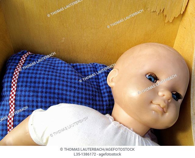Old doll in a pram