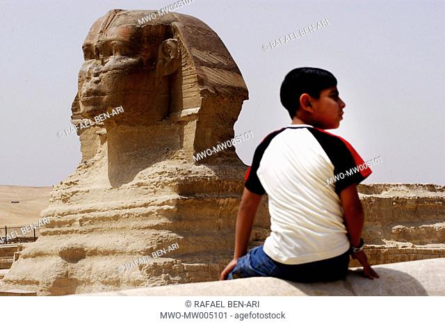 An Egyptian boy is looking away from the Great Sphinx For some 45 centuries, the great pyramids of Giza, Cairo have stood the test of time