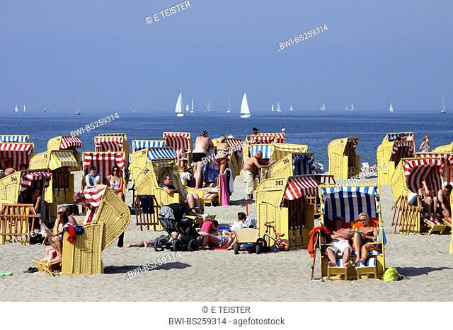 bathers in beach chairs on the sunlit Baltic Sea beach , Germany, Schleswig-Holstein, Travemuende, Luebeck