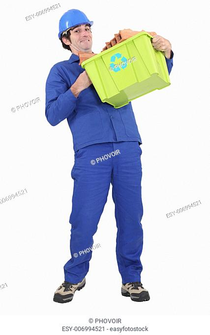Man carrying recycled waste