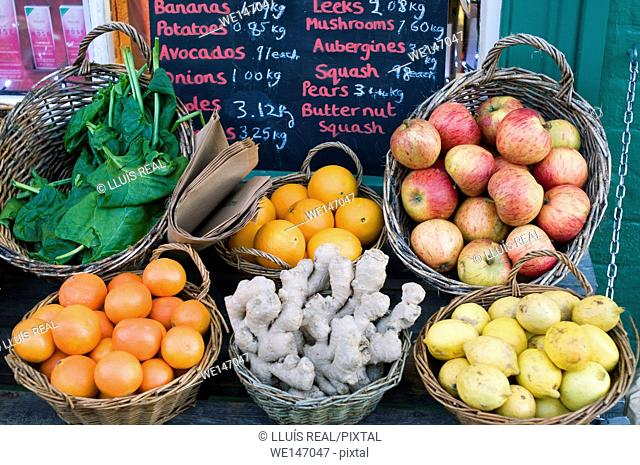 Fruits and vegetables in baskets for sale