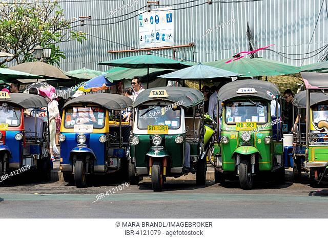 Tuktuk taxis parked in the street, Bangkok, Thailand