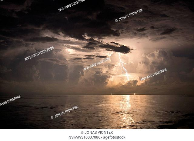 Positive cloud-to-ground discharge between powerful updrafts over lake Maracaibo (Catatumbo thunderstorm, the place with the highest lightning density...
