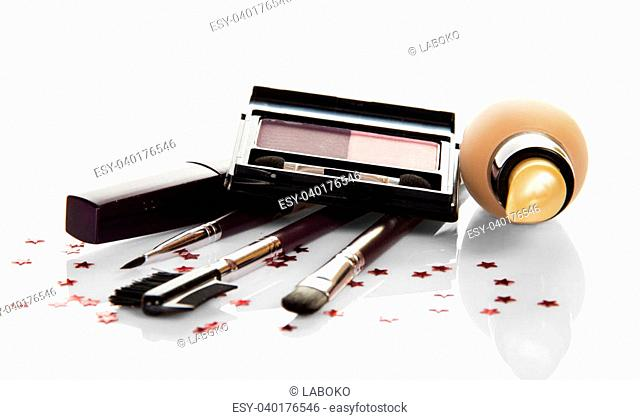 Basis for a make-up, mascara, eye shadow and a set of the brushes, isolated on white