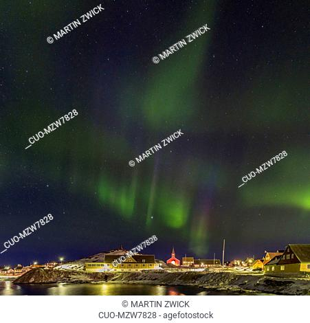 Northern lights over the old town and the colonial harbour . Nuuk, the capital of Greenland. America, North America, Greenland