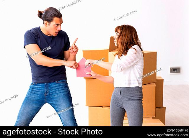 Young pair and many boxes in the divorce settlement concept
