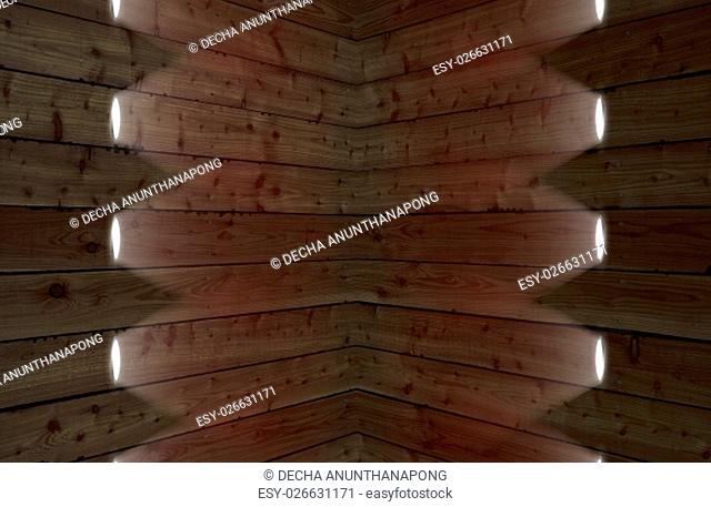 The brown barn wood wall & downlight. Wall texture background pattern